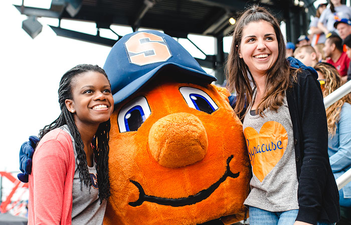 Two regional alumni with Otto at a baseball game