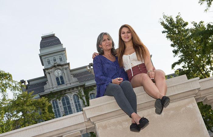 Photo of parent and student in front of the Hall of Languages